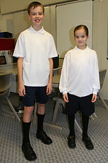 two Carey College students in junior uniform