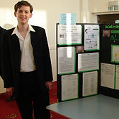 Carey College student with project on display