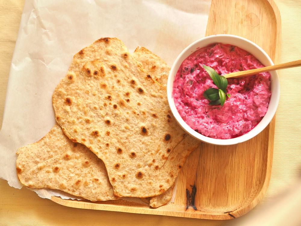 Beetroot raita dip eaten with flatbread or chapati