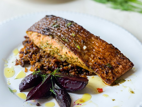Pan-fried salmon in Thai salsa verde on a bed of quinoa and lentil served with roasted beetroots.