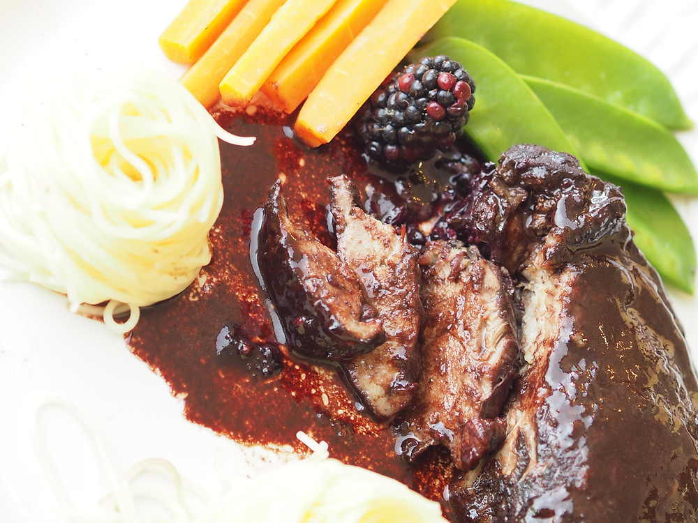 Roast duck legs with blackberry sauce