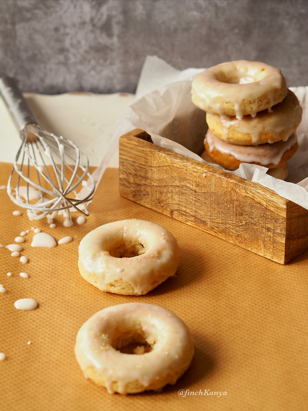 Soft and fluffy baked donuts glazed with icing sugar