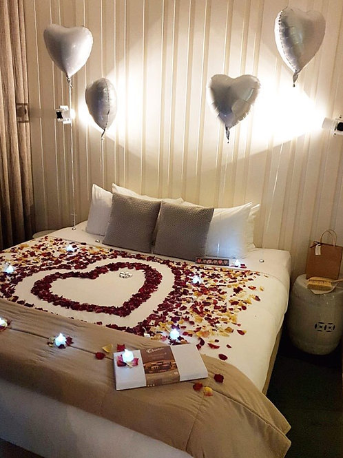 Rose Petals, Chocolates, Candlelight and Balloons