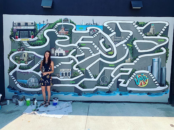 Michelle Boggess-Nunley working on a UNITY mural