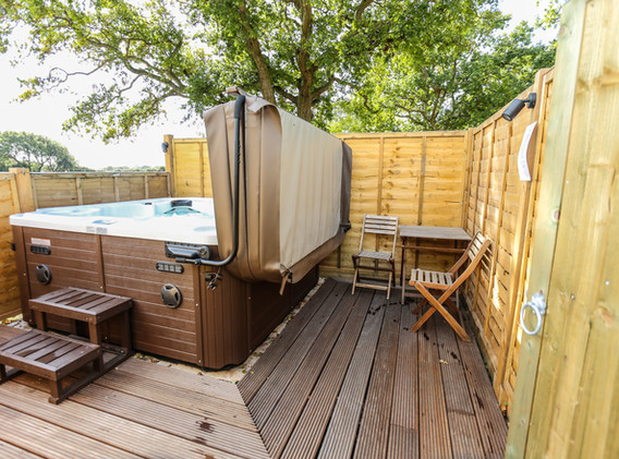 Hot tub with decking and table and chairs