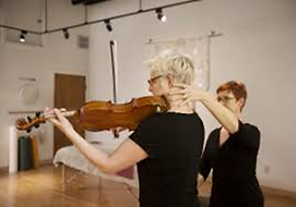 teaching a violinist