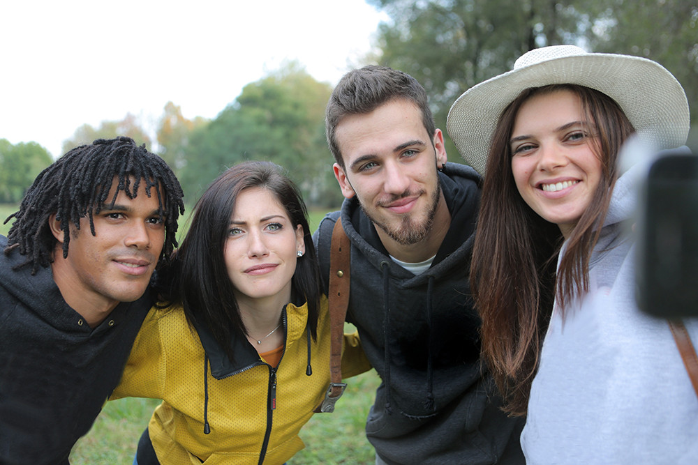 4 young people taking a selfie