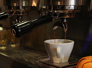 espresso pouring in coffee cup