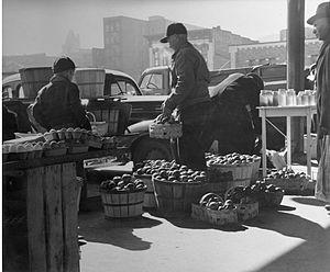 Farmer's unload produce at City Market