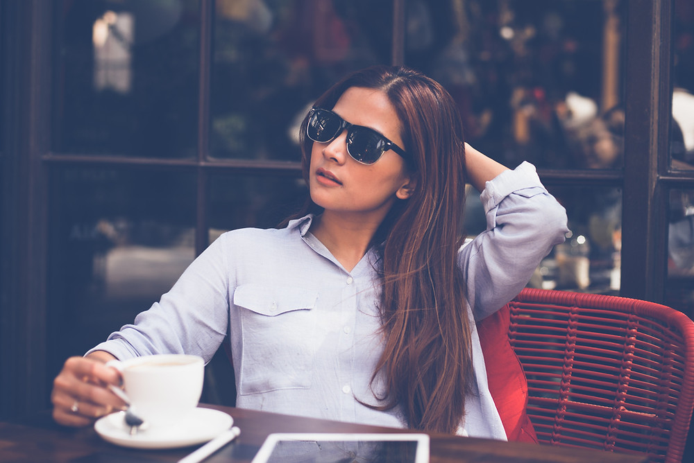 woman at cafe drinking coffee