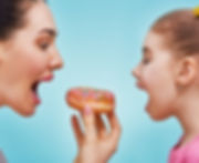 mother and daughter eating doughnut
