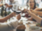 business people toasting with wine glasses