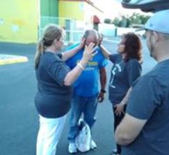 Praying on Street.PNG