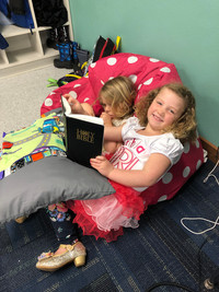 'Reading' and telling Bible stories!