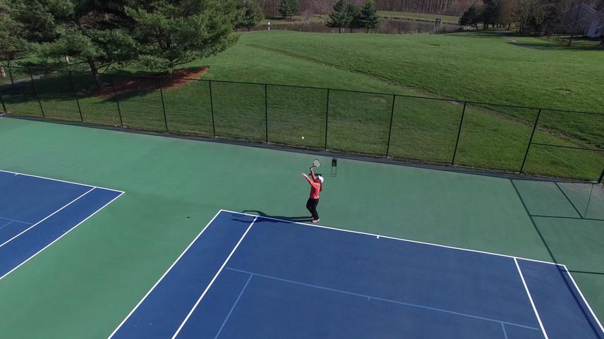 tennis serve w lake.jpeg