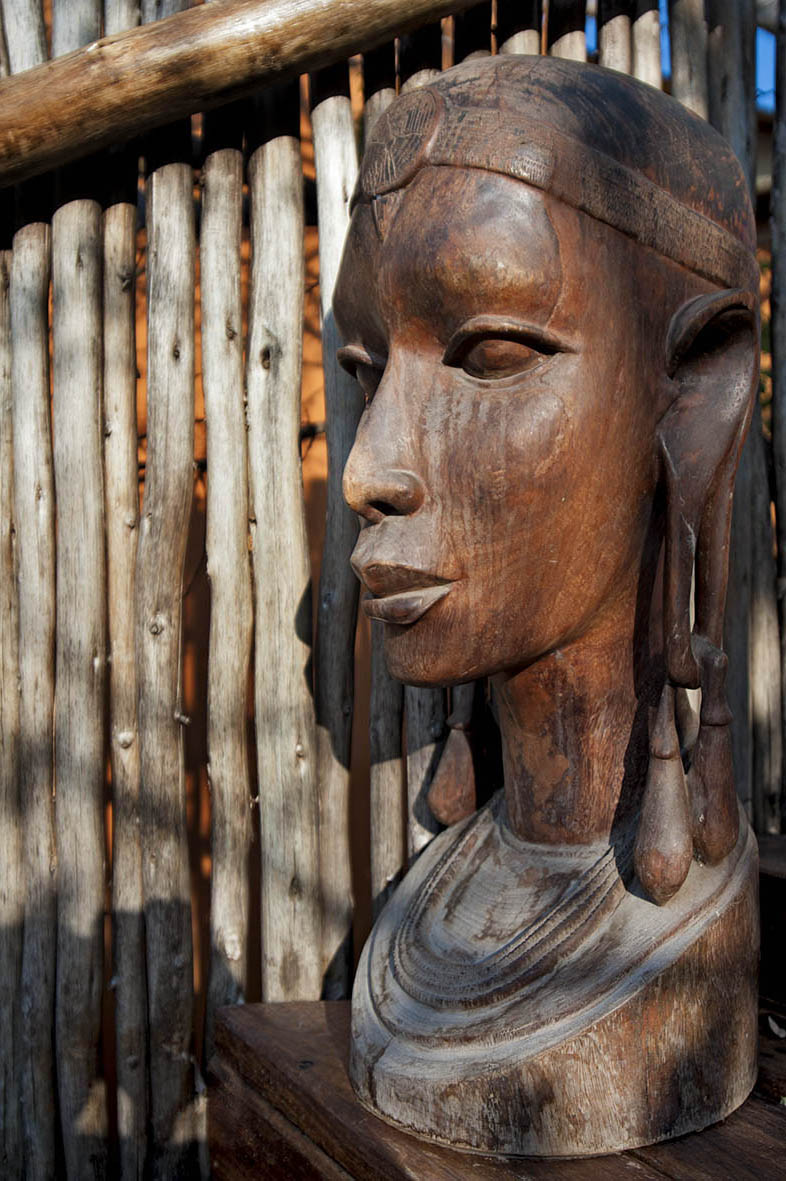 24. AZURA SELOUS WOOD FIGURE