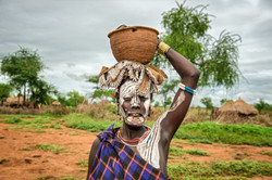 Woman-from-the-african-tribe-Mursi,-Omo-Valley,-Ethiopia-667056252_6016x4016