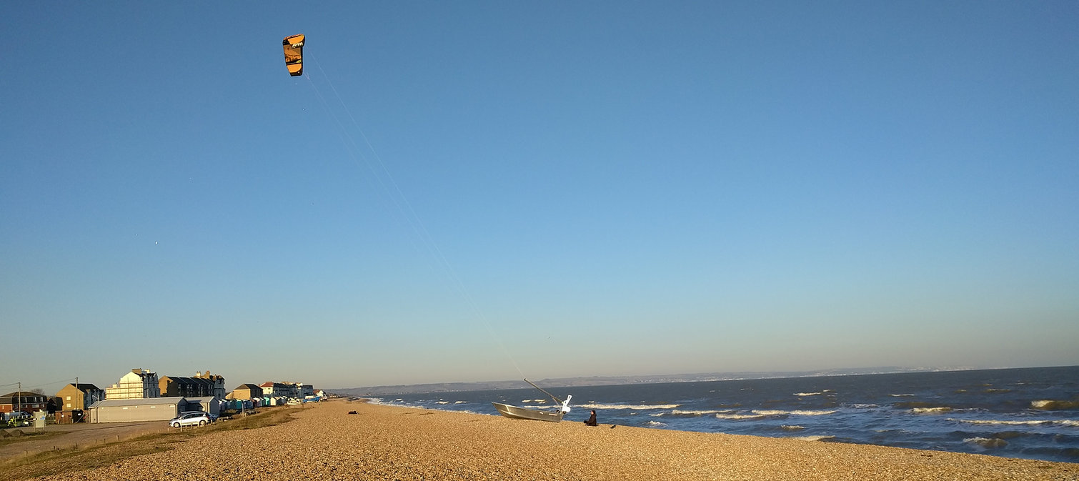A WindFly Rig prototype flying a kite on Greatstone beach