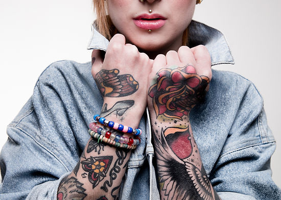 Portrait of a young women with tattoos