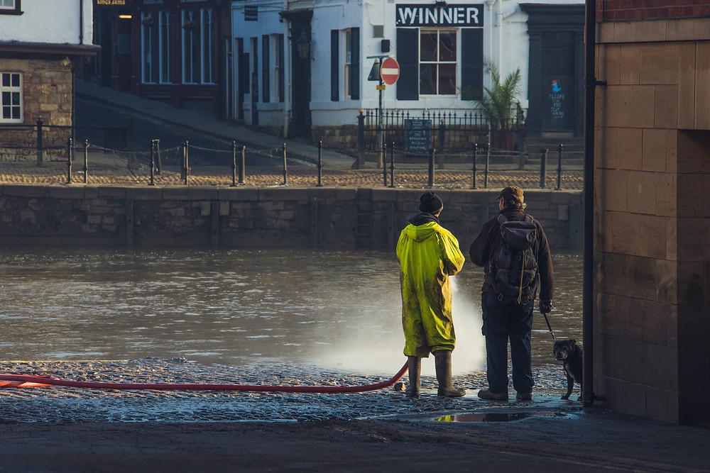 Man spraying his big hose