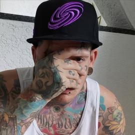 Tattoomodel Patient666 wearing the Galaxy Mix cap