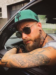 Tattoomodel Marc wearing the Zeus cap