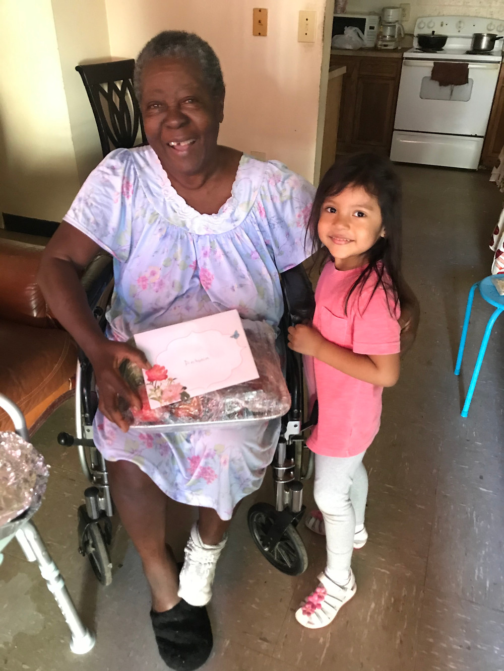 Antonia Benjamin, receiving a special meal and a gift on her Birthday.