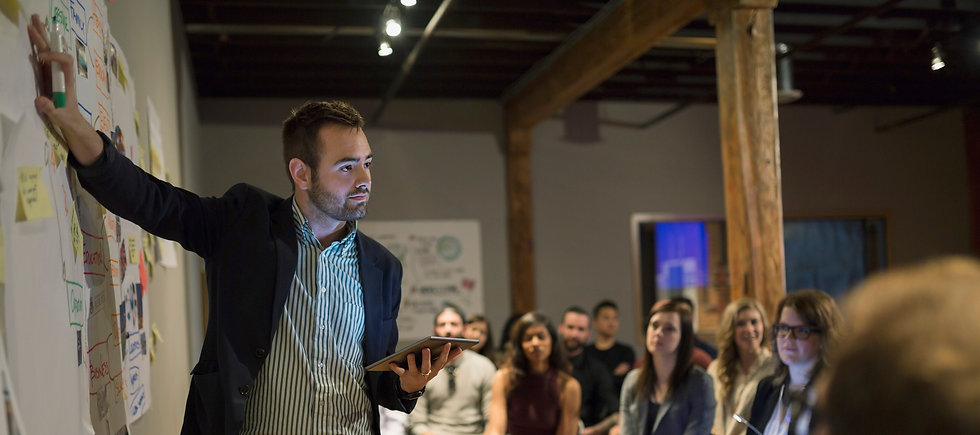 man presenting to a group