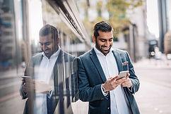 businessman using mobile app on smart phone