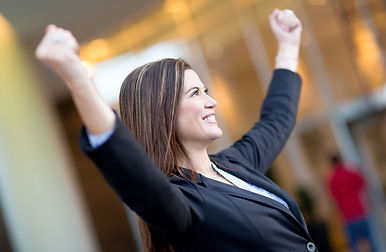 business woman smiling with arms in the air