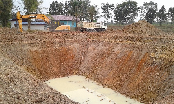 Constructing fish ponds in Thailand. The large size macro was 1,600 Thai baht per hour. The driver averaged approximately 5 hours per pond.