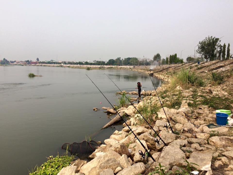 Fishing on the Ping river in Kamphaeng Phet province, Thailand.
