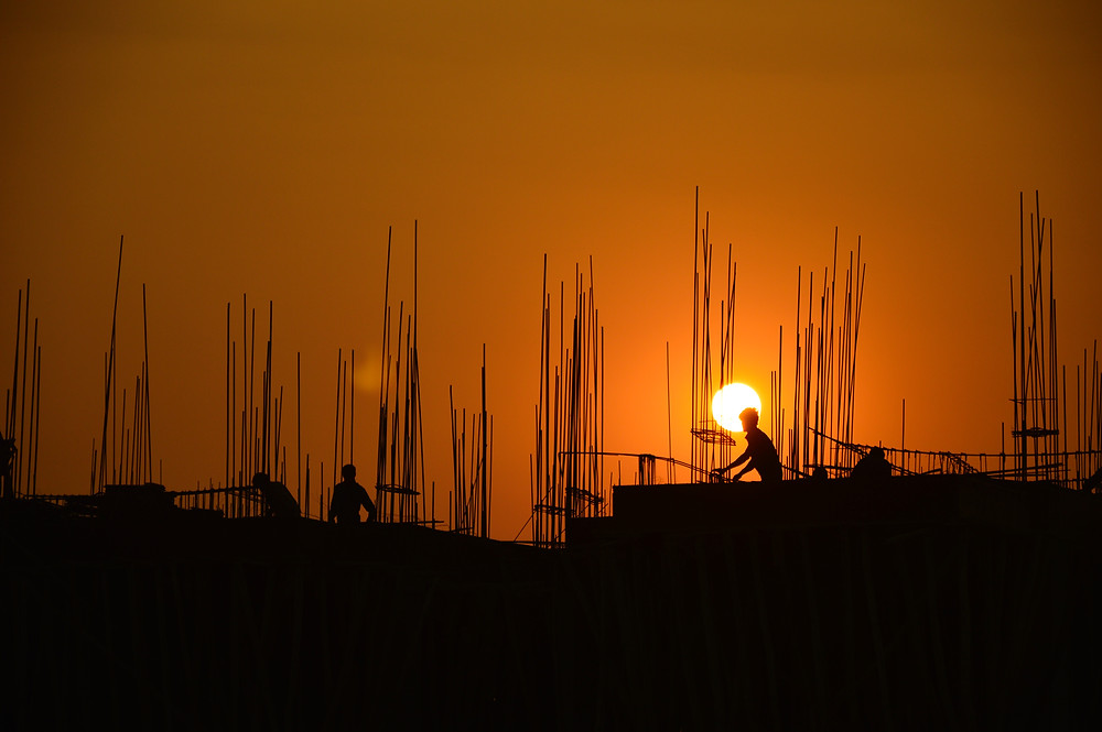 Thailand construction work using bamboo scaffolding.