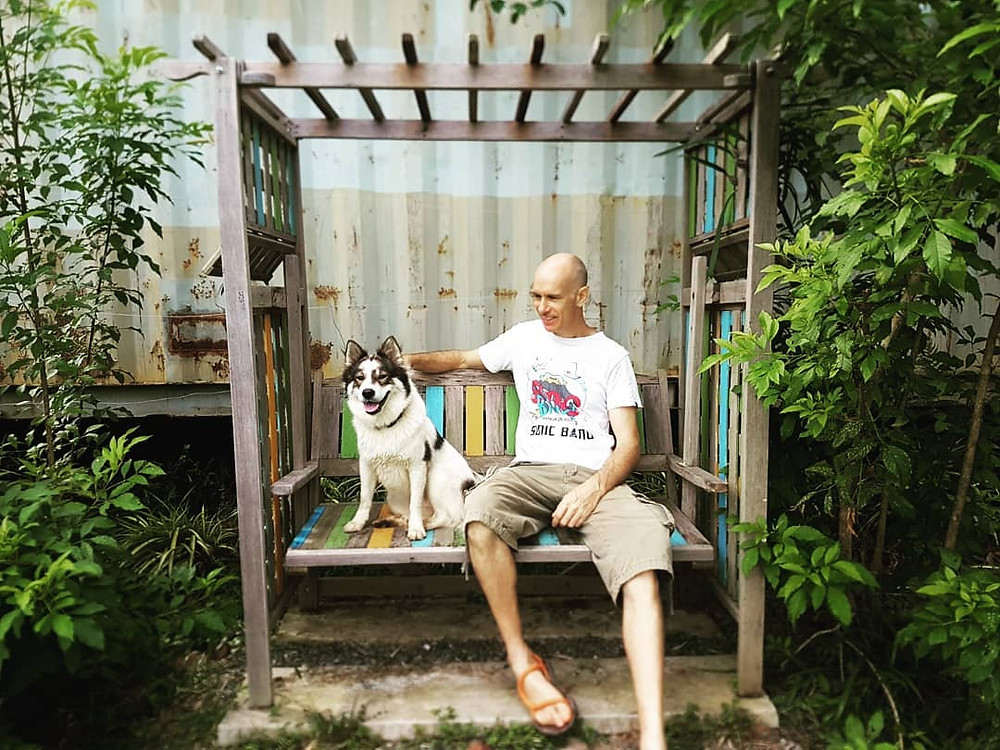 Sitting with a bangkaew thai dog