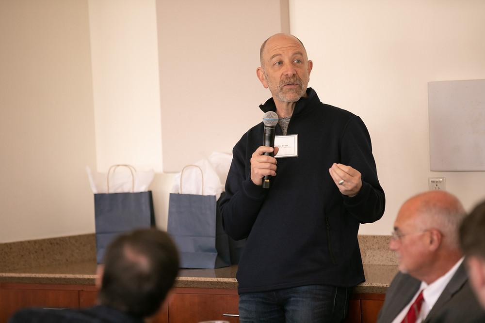 Steve Brett speaking to a group of investors