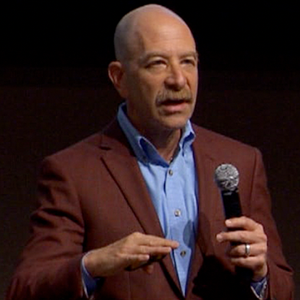 Steve Brett speaking at a TED session