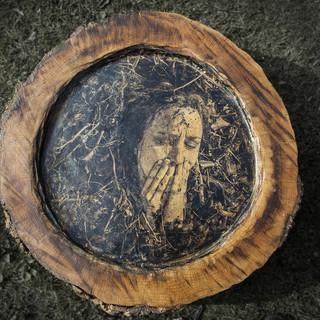 A Self Portrait on an oak round 2 © Gillian Allard 2013 Weird & Wonderful Wood Festival  Photograph bonded to an oak round 80cm x 80cm