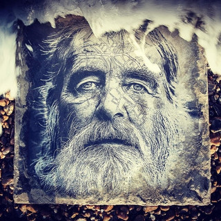 Malcolm Wright portrait -  Lowestoft, 2020 © Gillian Allard  Photographic image bonded to a concrete slab and reshot  at Dunwich Beach.