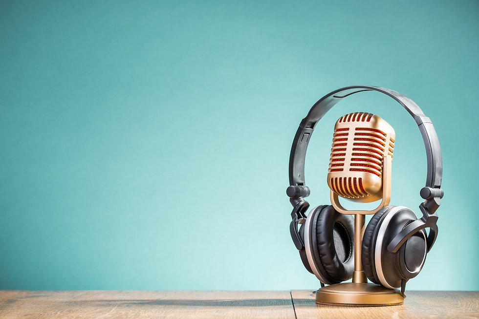 Retro golden microphone and headphones o