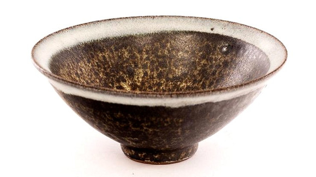 COOPER STONEWARE BOWL IN AUCTION