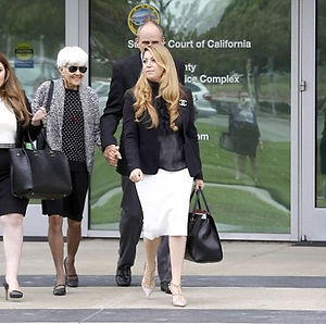 Tamar walking with clients after winning court case