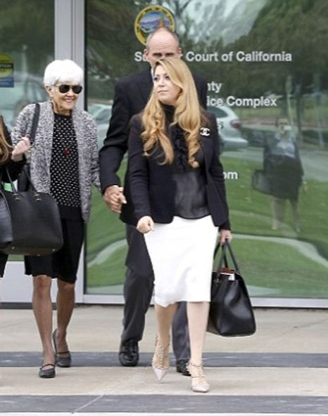 Attorney Tamar Arminak walking with clients after winning a court case