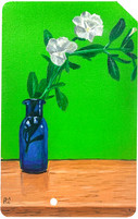 Small White Flower in a Blue Bottle