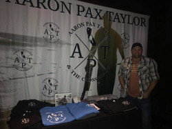 Aaron Pax Taylor with Merch table