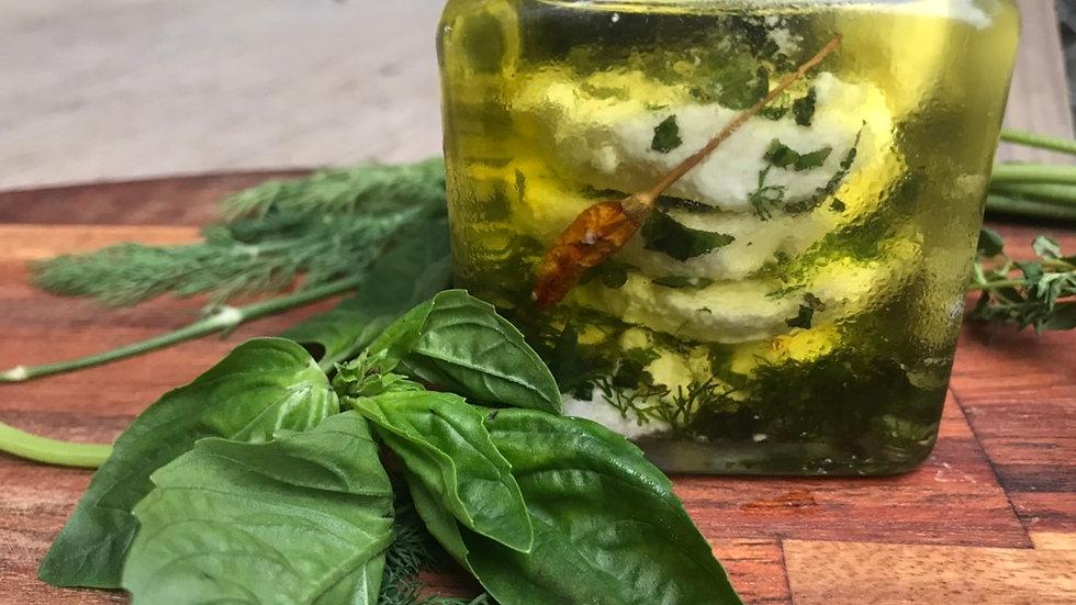 Marinated goat cheese in organic herbs (180ml jar)