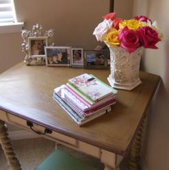 Kathryn Bechen's desk with roses.jpg