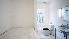 Would you live in this £1,625 flat where you can reach the toilet from your bed?