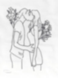 two people kissing with flowers.jpeg