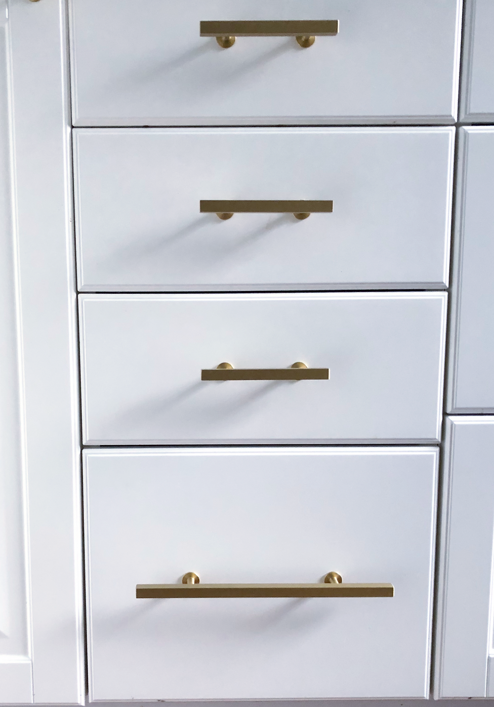 Gold hardware white cabinets