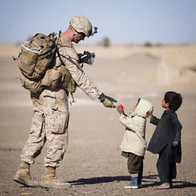 soldier-giving-red-fruit-on-2-children-d